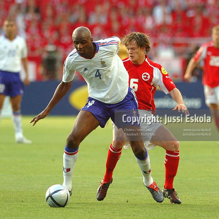 Patrick Vieira, Johann Vogel 21.6.2004.&amp;#xA;France-Swizerland.&amp;#xA;Euro 2004.&amp;#xA;Photo: Jussi Eskola<br />