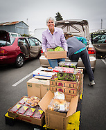 Strawberries, salad, and watermelons destined for one of Second Harvest's 100 member agencies