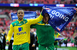 Norwich City's Martin Olsson celebrates with Norwich City's Elliott Bennett as Norwich City win promotion to the premier league   - Photo mandatory by-line: Joe Meredith/JMP - Mobile: 07966 386802 - 25/05/2015 - SPORT - Football - London - Wembley Stadium - Middlesbrough v Norwich - Sky Bet Championship - Play-Off Final