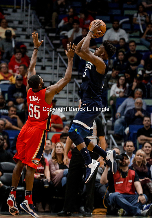 Nov 29, 2017; New Orleans, LA, USA; Minnesota Timberwolves guard Jimmy Butler (23) shoots over New Orleans Pelicans guard E'Twaun Moore (55) during the second half at the Smoothie King Center. The Timberwolves defeated the Pelicans 120-102. Mandatory Credit: Derick E. Hingle-USA TODAY Sports