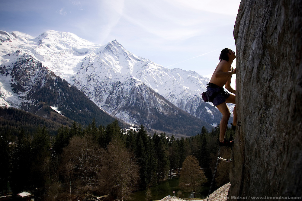 A young caucasian man sport climbs in Chamonix, France, near Mt. Blanc.