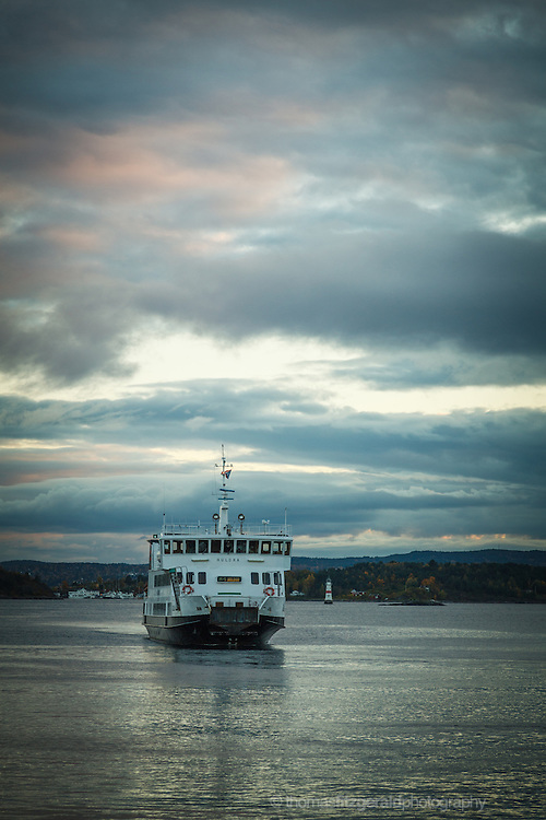 Oslo, Norway, October 2012: A ferry approaches the harbour from across the Oslo Fjord.EDITORIAL ONLY: This Image is only for Editorial Use