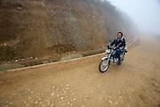 Hilltribe villages around Sapa. Black Hmong on motorbike.