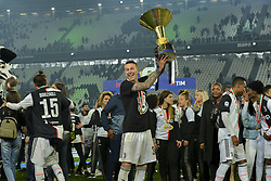 May 19, 2019 - Turin, Turin, Italy - Federico Bernardeschi of Juventus FC lifts the trophy of Scudetto  2018-2019 at Allianz Stadium, Turin (Credit Image: © Antonio Polia/Pacific Press via ZUMA Wire)