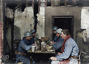 "Colorized photographs soldiers from the World War One<br /> <br /> With his impressive colorized photographs of the World War One, Frédéric Duriez gives us a new look at the conflict that ravaged the world between 1914 and 1918, revealing the difficult daily life of the French soldiers. <br /> <br /> Photo Shows: "" Neuvilly , 7 December 1915. """"La soupe"""" in the Police station. The uniforms are dirty because during this period of incessant rains ( for 6 days) overwhelmed their trenches .<br /> ©Frédéric Duriez/Exclusivepix Media"