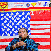 100114       Cable Hoover<br /> <br /> Cecelia Fred sits in front of a quilt that was made in her honor as she gives a speech during a luncheon at the San Juan Center for Independence in Gallup Wednesday.