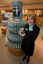 © licensed to London News Pictures. London, UK 23/04/2012. A Fortnum & Mason staff posing with a Heinz can as Heinz launching a limited edition set of cans to honour the Queens Diamond Jubilee at Fortnum & Mason, this morning (23/04/12). Photo credit: Tolga Akmen/LNP