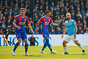 Crystal Palace defender Patrick van Aanholt (3), Crystal Palace defender Patrick van Aanholt (3) and Manchester City forward Sergio Aguero (10) during the Premier League match between Crystal Palace and Manchester City at Selhurst Park, London, England on 14 April 2019.