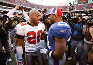 Ronder Barber and Tiki Barber greet each other on the field following the Bucs loss to the Giants during the Tampa Bay Buccaneers vs. New York Giants at Giants Stadium Sunday (10/29/06).  BRENDAN FITTERER | Times SUMMARY: Tampa Bay Buccaneers vs. New York Giants at Giants Stadium