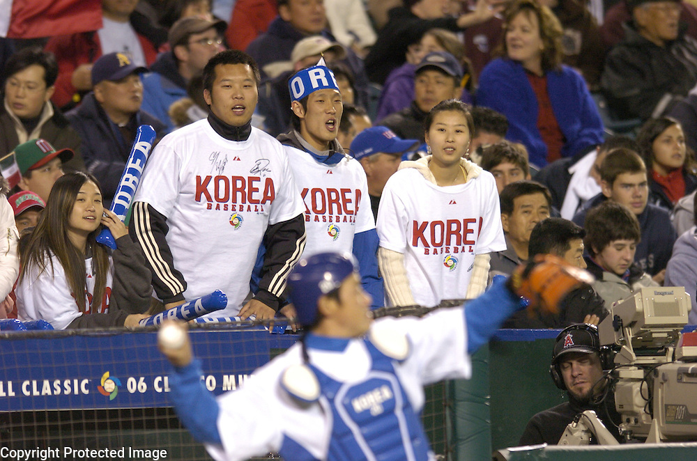 Team Korea fans cheer before the start of Round 2 action against Team Mexico at Angel Stadium of Anaheim.