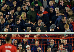LIVERPOOL, ENGLAND - Thursday, March 10, 2016: Manchester United supporters fight amongst themselves as Liverpool lead 1-0 during the UEFA Europa League Round of 16 1st Leg match at Anfield. (Pic by David Rawcliffe/Propaganda)
