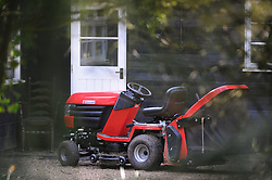 © Licensed to London News Pictures. 08/04/2014<br /> Peaches Geldof Death.<br /> Police outside the home of Peaches Geldof this morning (08.04.2014) after she died yesterday at the age of 25 years.<br /> Red lawnmower outside the house.<br /> Photo credit :Grant Falvey/LNP
