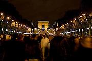People gather for New Year's Eve celebrations in Champs-Élysées, by the Arc de Triomphe, Paris, France