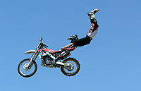 Jul 01, 2003; Anaheim, California, USA; Moto X star athlete ROBERT DISTLER executing a tremendous stunt hands &amp; feet free flying through the air with a full sized motobike at the opening of Disney's California Adventure &quot;X Games Experience&quot;.  Disney park has built two X-Arena's specifically for this 41 day event highlighting extreme sports for the launch of the 2003 ESPN X Games.<br />