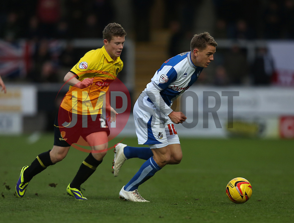 Bristol Rovers' Eliot Richards gets away from Burton Albion's Matthew Palmer- Photo mandatory by-line: Matt Bunn/JMP - Tel: Mobile: 07966 386802 23/11/2013 - SPORT - Football - Burton - Pirelli Stadium - Burton Albion v Bristol Rovers - Sky Bet League Two