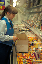 Trainee shelf filler in Farmfoods supermarket UK