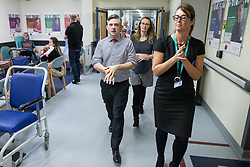 © Licensed to London News Pictures. 26/01/2018. Lancaster, UK. Shadow Health Secretary JONATHAN ASHWORTH MP and Lancaster and Fleetwood MP CAT SMITH walk through corridors , during a visit Lancaster Royal Infirmary and tour Accident and Emergency and the wards on a day when the A&E department at the hospital was at 100% of capacity with no spare cubicles . Labour say the NHS is in crisis in the North West with patients waiting in ambulances outside hospitals for over an hour and hospitals running out of beds. Photo credit: Joel Goodman/LNP