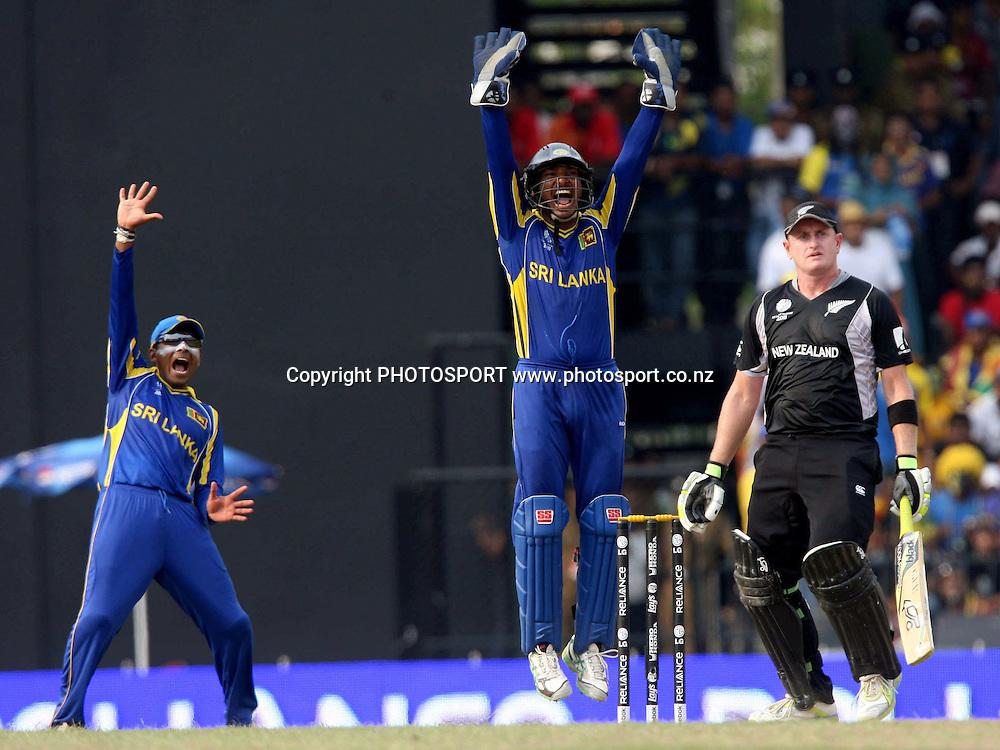 Sri Lankan captain Kumar Sangakkara ans Mahila Jayawardane appile against New Zealand batsman Scott Styris during ICC Cricket World Cup - 1st Semi-Final New Zealand vs Sri Lanka Played at R Premadasa Stadium, Colombo, 29 March 2011 - day/night (50-over match)