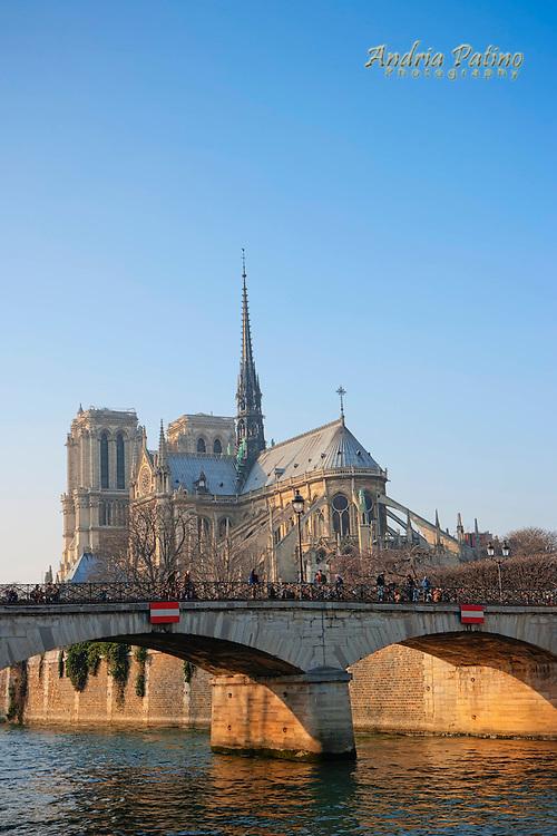 Notre Dame de Paris and The Archbishop's Bridge at sunset