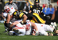 18 OCTOBER 2008: Wisconsin running back John Clay (32) is pulled down by Iowa defensive lineman Matt Kroul (53) and Iowa linebacker Pat Angerer (43) in the first half of an NCAA college football game against Wisconsin, at Kinnick Stadium in Iowa City, Iowa on Saturday Oct. 18, 2008. Iowa won 38-16.