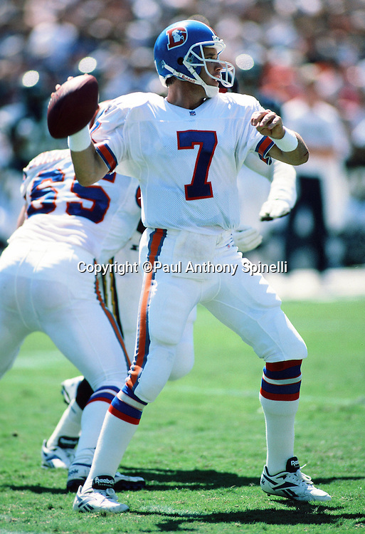 Denver Broncos quarterback John Elway (7) throws a pass during the NFL football game against the San Diego Chargers on Sept. 24, 1995 in San Diego. The Chargers won the game 17-6. (©Paul Anthony Spinelli)