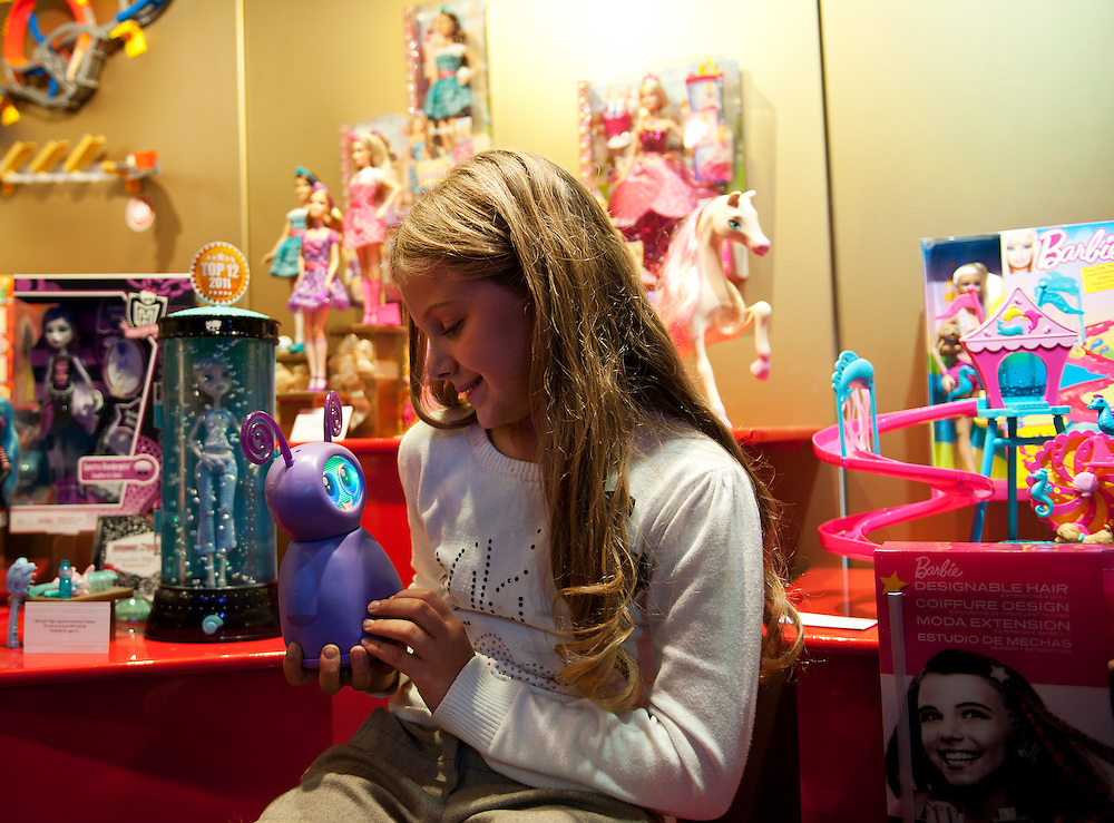 Isabelle Canham plays with Fijit Friends priced at £54.99 on October 26th 2011 at the Dream Toys exhibition....