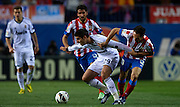 MADRID, SPAIN - APRIL 27: (L) Alvaro Morata of Real Madrid CF being fouled by (R) Juanfran Torres of Club Atletico de Madrid during the Liga BBVA between Club Atletico de Madrid and Real Madrid CF at the Vicente Calderon stadium on April 27, 2013 in Madrid, Spain. (Photo by Aitor Alcalde Colomer).