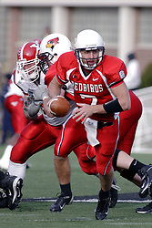 28 October 2006: Luke Drone steps into the backfield after taking the snap. Youngstown State turned off over 15,000 fans as the win blew their way, cooling off Illinois State 27-13. Nationally ranked teams Youngstown State Penguins and Illinois State Redbirds competed at Hancock Stadium on the campus of Illinois State University in Normal Illinois.<br />