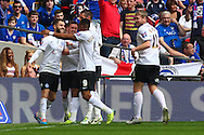 Josh McQuoid of Peterborough United (left) celebrates scoring the opening goal during the Johnstone's Paint Trophy Final match at Wembley Stadium, London<br /> Picture by David Horn/Focus Images Ltd +44 7545 970036<br /> 30/03/2014