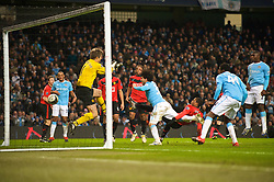 MANCHESTER, ENGLAND - Tuesday, January 19, 2010: Manchester City's Carlos Tevez scores the second goal against Manchester United during the Football League Cup Semi-Final 1st Leg at the City of Manchester Stadium. (Photo by David Rawcliffe/Propaganda)