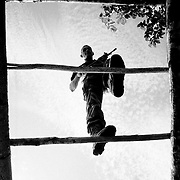 A FARC recruit crossed overhead bars on an assault course built in his camp in Caqueta.<br />