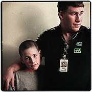 Economy special section:  Boeing worker Scott Grant is a single dad who was to be laid of January 1, part of the 48,000 people the company says it will let go in the next 2? years. PLEASE CHECK THIS. His son is J.C. Scott, 10. : ECONOMIC OUTLOOK '99 : SCOTT GRANT AND SON J.C. ( 1 OF 17 )