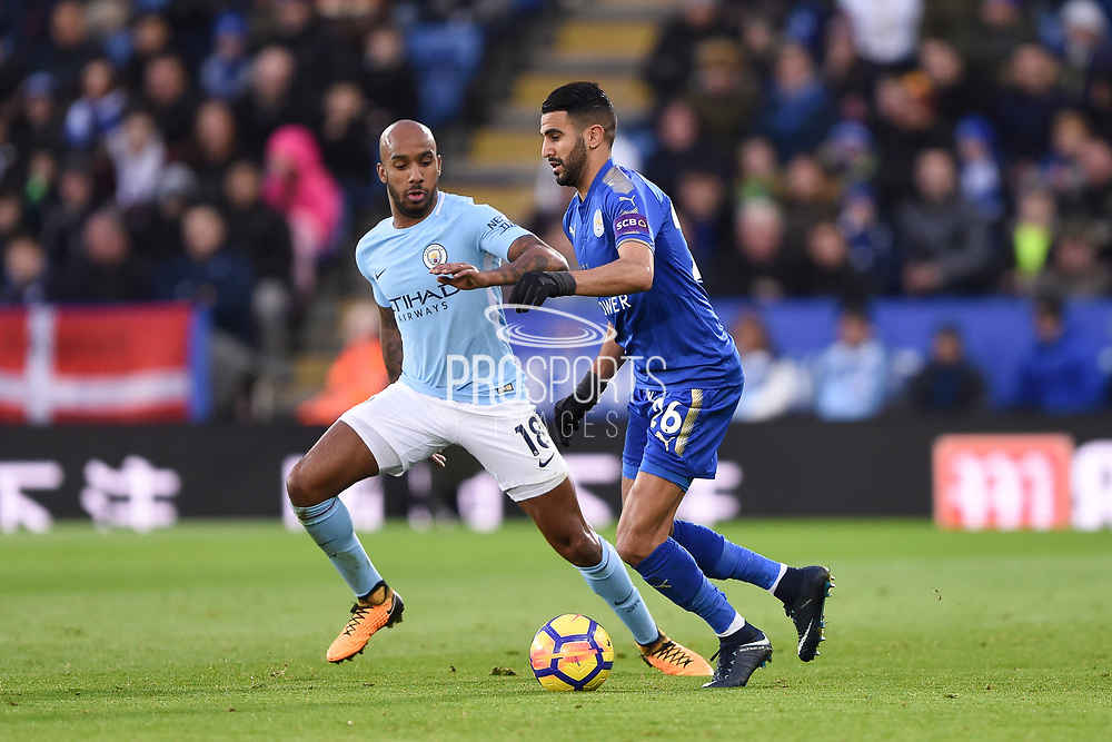 Leicester City midfielder Riyad Mahrez (26) battles with Manchester City midfielder Fabian Delph (18) during the Premier League match between Leicester City and Manchester City at the King Power Stadium, Leicester, England on 18 November 2017. Photo by Jon Hobley.