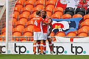Jim McAlister (4) celebrates with goalscorer Kyle Vassell after he scores the opening goal for Blackpool during the EFL Sky Bet League 2 match between Blackpool and Exeter City at Bloomfield Road, Blackpool, England on 6 August 2016. Photo by Craig Galloway.