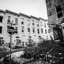 Cincinnati Glencoe-Auburn abandoned buildings. The Glencoe-Auburn Hotel and Glencoe-Auburn Place Row Houses were built in the late 1800's and are listed on the U.S. National Register of Historic Places. The complex is currently abandoned and in extremely poor condition. Photo is black and white high resolution.