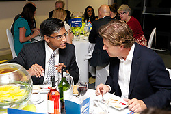 LIVERPOOL, ENGLAND - Wednesday, June 12, 2013: Professor Gerald Pillay and Tournament Director Anders Borg during a Gala Dinner for the sponsors of the Liverpool Hope International Tennis Tournament hosted by Liverpool Hope University at Hope Park. (Pic by David Rawcliffe/Propaganda)