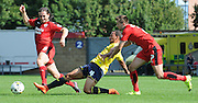 Gwion Edwards and Luke Rooney closing down Kemar Roofe during the Sky Bet League 2 match between Oxford United and Crawley Town at the Kassam Stadium, Oxford, England on 8 August 2015. Photo by Michael Hulf.
