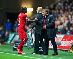 SWANSEA, WALES - Monday, September 16, 2013: Liverpool's manager Brendan Rodgers and Victor Moses during the Premiership match against Swansea City at the Liberty Stadium. (Pic by David Rawcliffe/Propaganda)