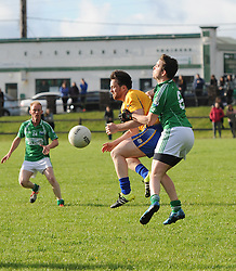 Breaking Ball Achill&rsquo;s Colm Mac Eamharcaigh and  Knockmore&rsquo;s alan Loftus compete for posession during the junior champonship match in Achill on saturday evening.<br /> Pic Conor McKeown