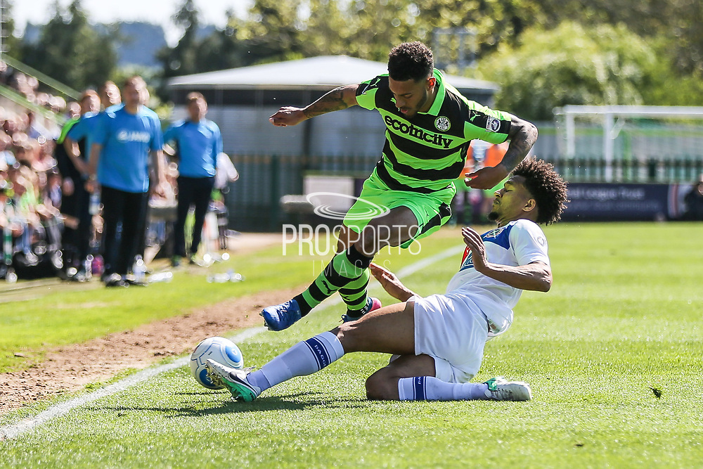 Forest Green Rovers Kaiyne Woolery(14) is tackled by Dagenham's Joe Widdowson(3) during the Vanarama National League Play Off second leg match between Forest Green Rovers and Dagenham and Redbridge at the New Lawn, Forest Green, United Kingdom on 7 May 2017. Photo by Shane Healey.