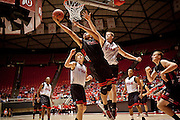 "Jordan Loveridge reaches up for a basket during the ""Night with the Runnin' Utes"" in the Jon Huntsman Center, Wednesday, Oct. 24, 2012."