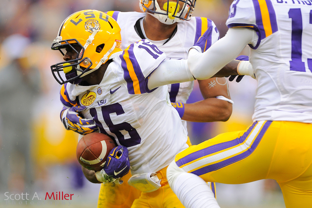 LSU Tigers defensive back Tre'Davious White (16) celebrates after an interception against Iowa in the 2014 Outback Bowl at Raymond James Stadium on Jan. 1, 2014 in Tampa, Florida. <br /> <br /> &copy;2014 Scott A. Miller