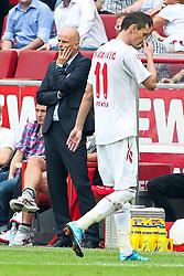 06.08.2011,  Rhein Energie Stadion, Koeln, GER, 1.FBL, 1. FC Koeln vs Vfl Wolfsburg, im Bild.Milivoje Novakovic (Koeln #11) (R) verlässt den Platz nach seiner roten Karte. Stale Solbakken (Trainer Koeln) (L) ist ebenfalls entaeuscht / entäuscht / traurig..// during the 1.FBL, 1. FC Koeln vs Vfl Wolfsburg on 2011/08/06, Rhein-Energie Stadion, Köln, Germany. EXPA Pictures © 2011, PhotoCredit: EXPA/ nph/  Mueller *** Local Caption ***       ****** out of GER / CRO  / BEL ******