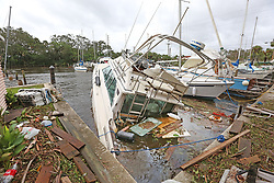 September 11, 2017 - Palm Shores, Florida, U.S. - One of eight sunken boats at Sundance Marine. Debris from sunken boats and docks washed over the seawall onto the land as Hurricane Irma winds blew from the east. (Credit Image: © Red Huber/TNS via ZUMA Wire)
