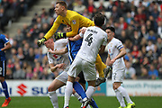 David Martin 1 punches clear from Calvin Andrew (9) during the EFL Sky Bet League 1 match between Milton Keynes Dons and Rochdale at stadium:mk, Milton Keynes, England on 11 March 2017. Photo by Daniel Youngs.
