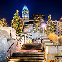 Charlotte at night with Romare Bearden Park stairs and the Bank of America Corporate Center building. Charlotte is a major city in North Carolina in the Eastern United States of America.