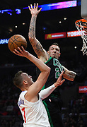 Boston Celtics forward Daniel Theis #27 goes up to block a shot by LA Clippers forward Sam Dekker #7 in the first half. The Los Angeles Clippers played the Boston Celtics in a regular season NBA matchup in Los Angeles, CA 1/025/2018 (Photo by John McCoy, Los Angeles Daily News/SCNG)
