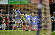 The Portsmouth players celebrate Conor Chaplin's opening goal during the Capital One Cup match between Portsmouth and Reading at Fratton Park, Portsmouth, England on 25 August 2015. Photo by Adam Rivers.