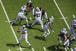 EAST RUTHERFORD, NJ - SEPTEMBER 7: Geno Smith (7) of the New York Jets drops back to pass during their game against the Oakland Raiders at MetLife Stadium on September 7, 2012 in East Rutherford, NJ.  (Photo by Ed Mulholland/Getty Images) *** Local Caption *** Geno Smith
