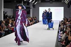 © Licensed to London News Pictures. 04/06/2018. London, UK.  A model presents a look by Bethany Hilton from Birmingham University on day two of Graduate Fashion Week taking place at the Old Truman Brewery in East London. The event presents the graduation show of up and coming fashion designers from UK and international universities.  Photo credit: Stephen Chung/LNP